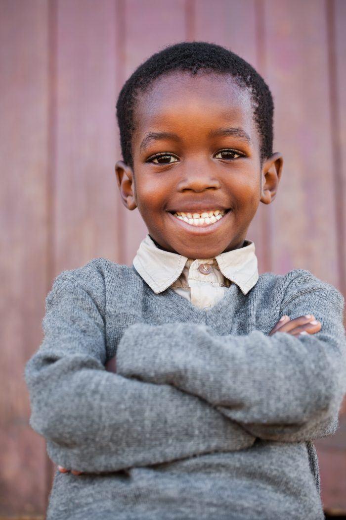 young boy smiles at camera