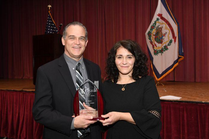 Jeff Culpepper accepts pro bono award plaque from Kate White