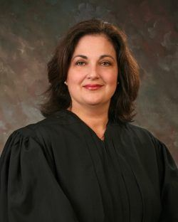 Pictures of Honorable Gina M. Groh, Chief United States District Judge of the United States District Court for the Northern District of West Virginia.